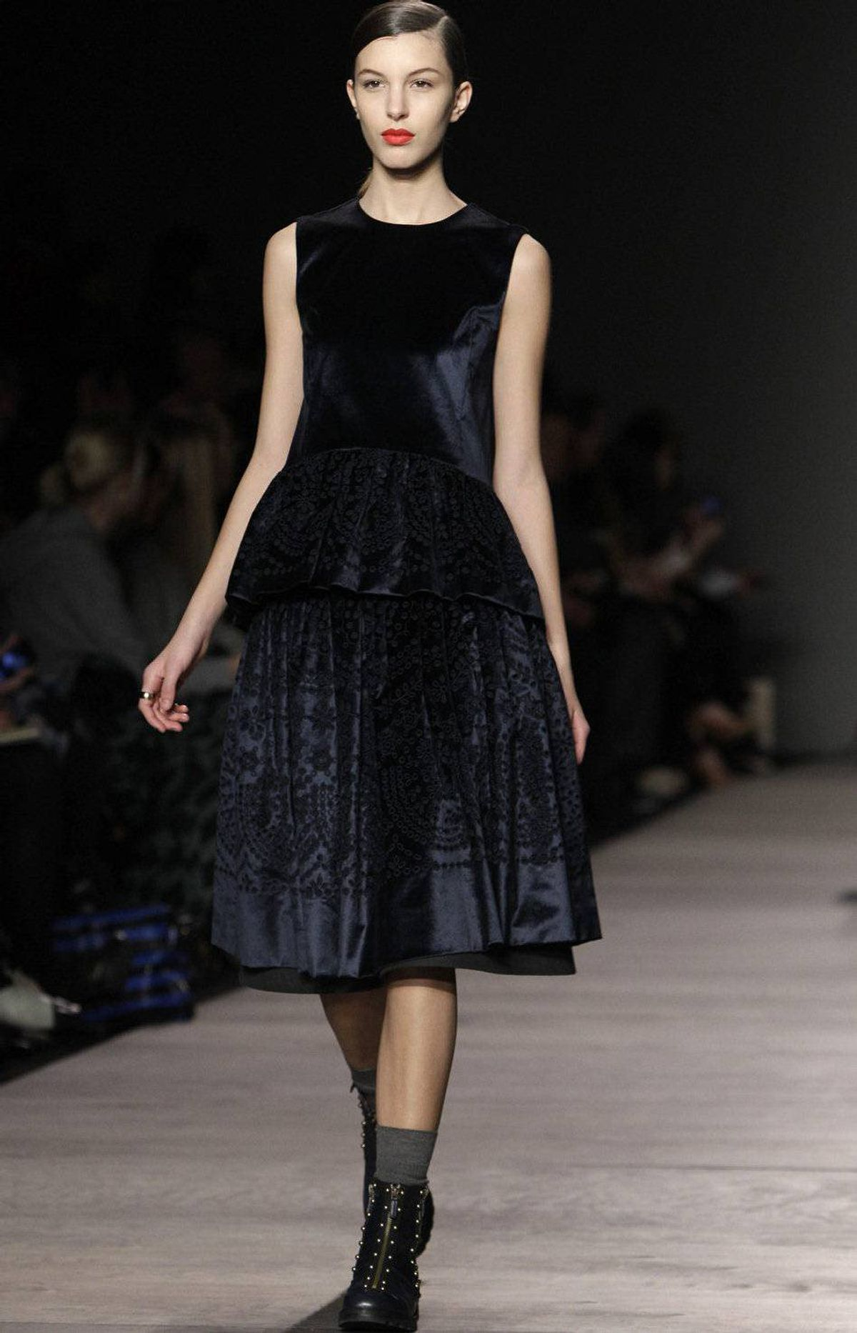 Do you remember Tory Burch's inspiration from earlier – a prim girl hanging out with the wrong kind of guy? I get that message with this velvet dress and motorcycle boot look. And, yet, I'm sure she's having fun.