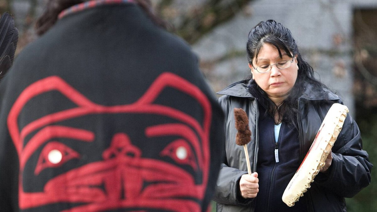 In 2007, Mary Jacobs drums during a native prayer circle outside the court house while a sentencing hearing for convicted murderer Robert Pickton was being held in New Westminster.