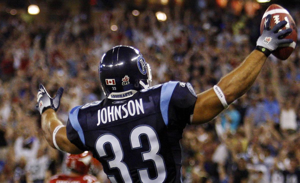 Toronto Argonauts fullback Jeff Johnson celebrates his touchdown against the Calgary Stampeders during the second half of their CFL football game in Toronto July 14, 2010. REUTERS/Mark Blinch