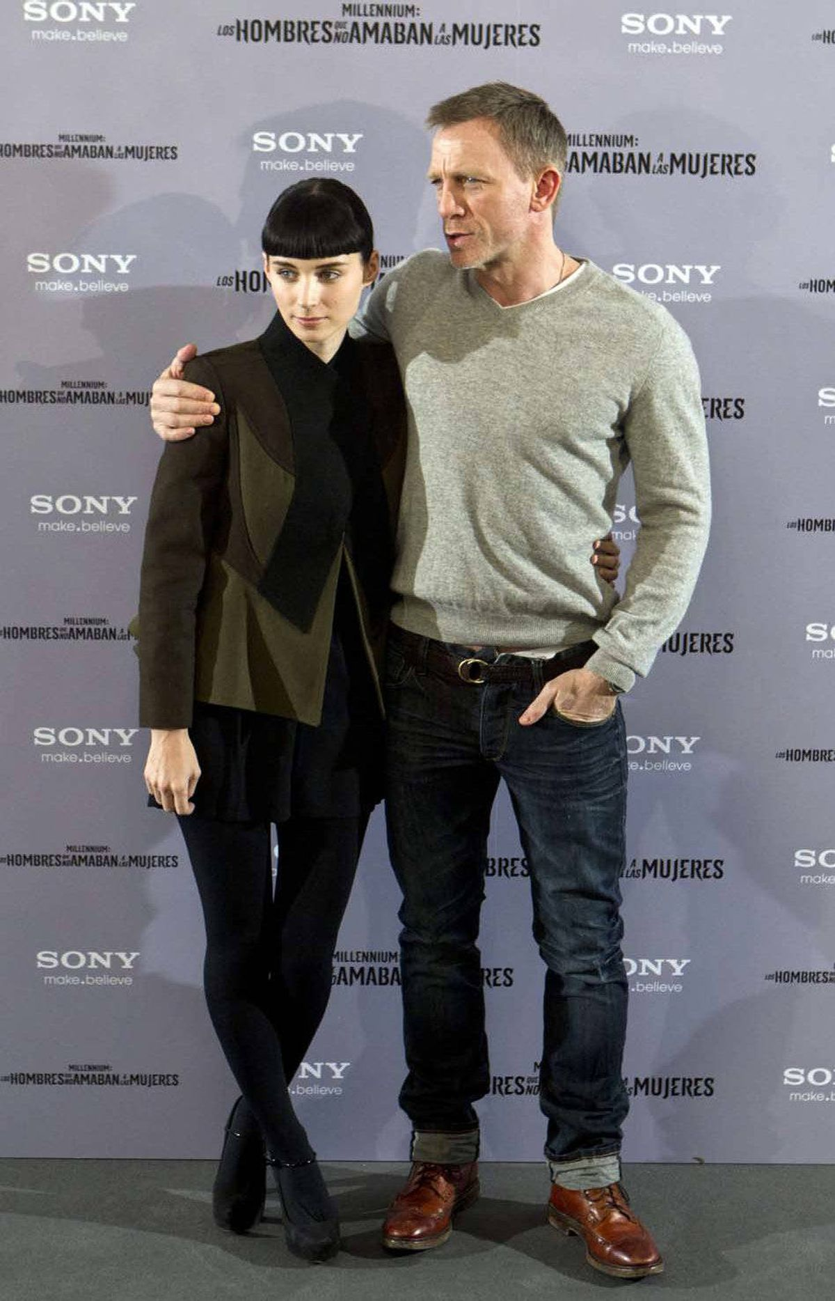 """Daniel Craig poses with his pants undone while holding Rooney Mara at the Spanish premiere of """"The Girl with the Dragon Tattoo"""" in Madrid last week."""