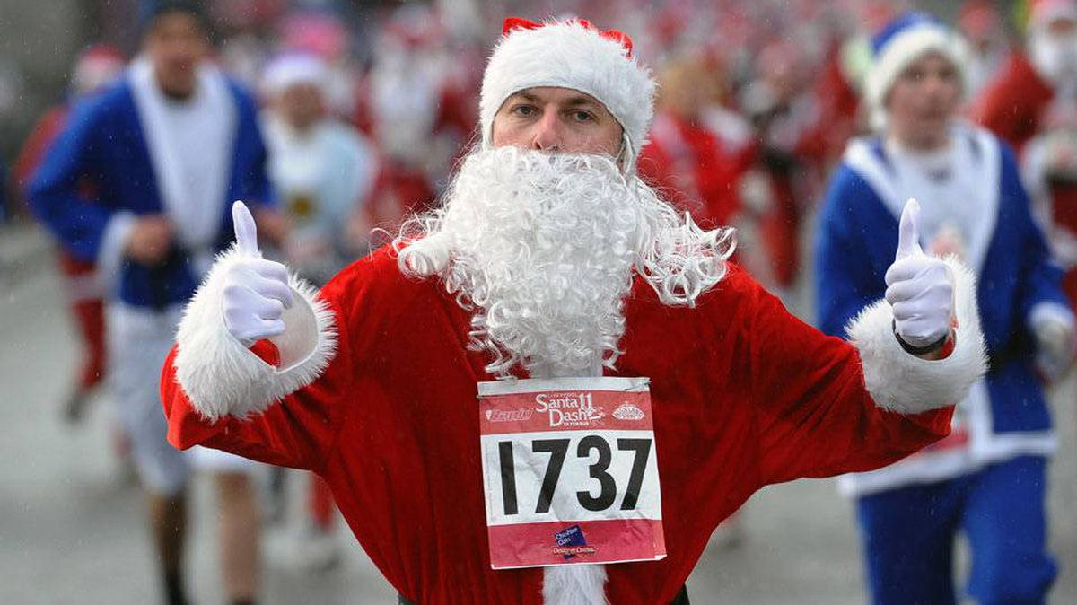 Santa raises takes part in the annual Santa Dash in Liverpool, England.