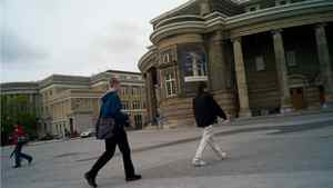Students walk past Convocation Hall at the University of Toronto.