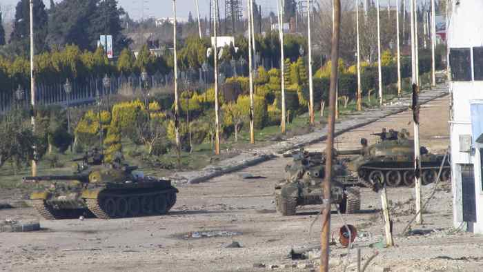 Syrian tanks are seen in Bab Amro near the city of Homs Feb. 12, 2012.