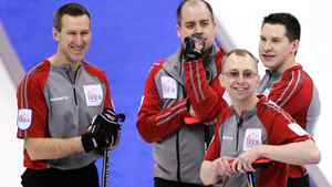 NWT/Yukon second Brad Chorostkowski, left to right, skip Jamie Koe, third Tom Naugler and lead Robert Borden pause for a moment during an afternoon draw against Nova Scotia at the Tim Hortons Brier in Saskatoon, Saturday, March, 3, 2012. THE CANADIAN PRESS/Jonathan Hayward