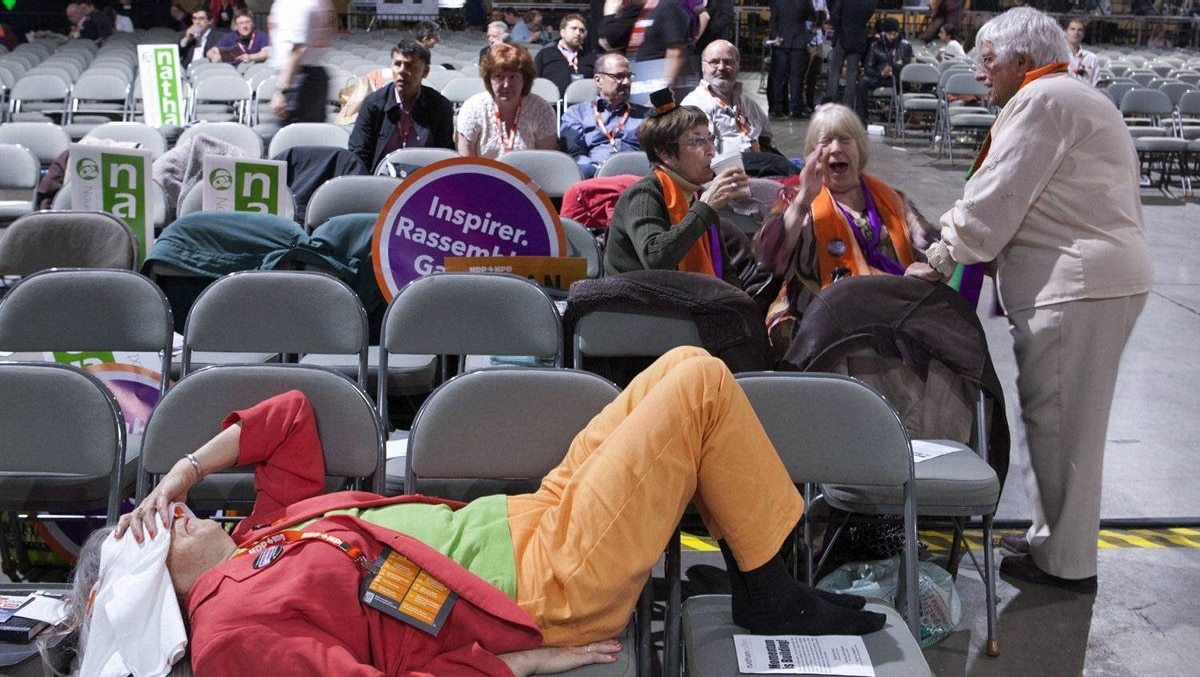 An NDP supporter rests during the third ballot at the party's leadership convention in Toronto on March 24, 2012.
