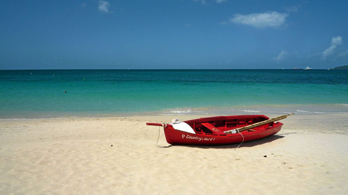 A quiet moment on Grand Anse beach in Grenada: The three-kilometre white sand beach on the Caribbean Sea is a popular destination for tourists and locals alike.