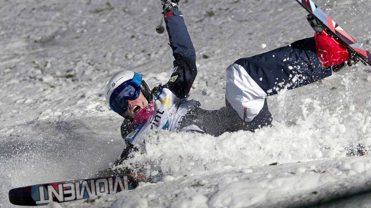 Heather McPhie of the U.S. crashes during the women's dual moguls at the FIS Freestyle World Ski Championships in Park City Feb. 5, 2011
