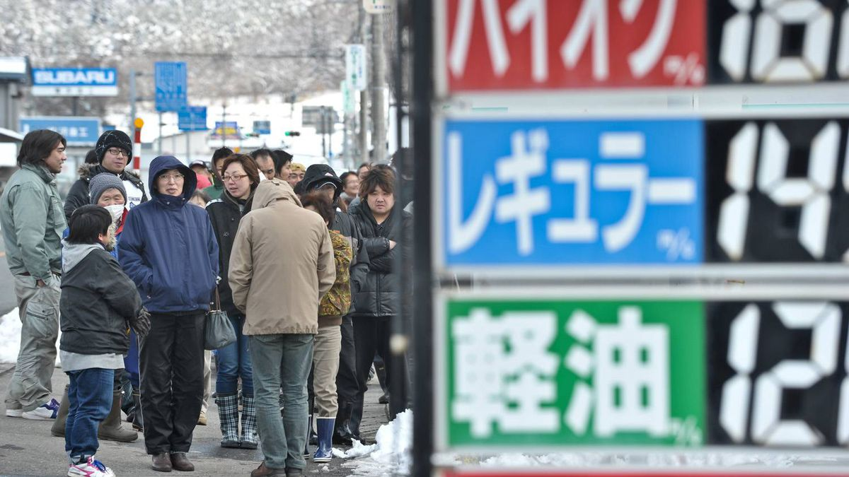 People wait in line in front of a closed petrol station to get a number to be able to get fuel later in the day in the town of Tonoi on March 17, 2011, six days after a major earthquake and tsunami hit the northeastern coast of Japan.