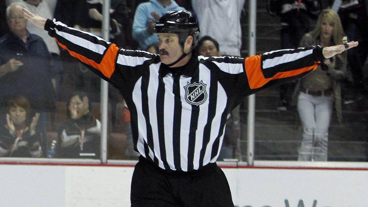 Referee Francois St. Laurent signals no goal on an overtime shootout shot .