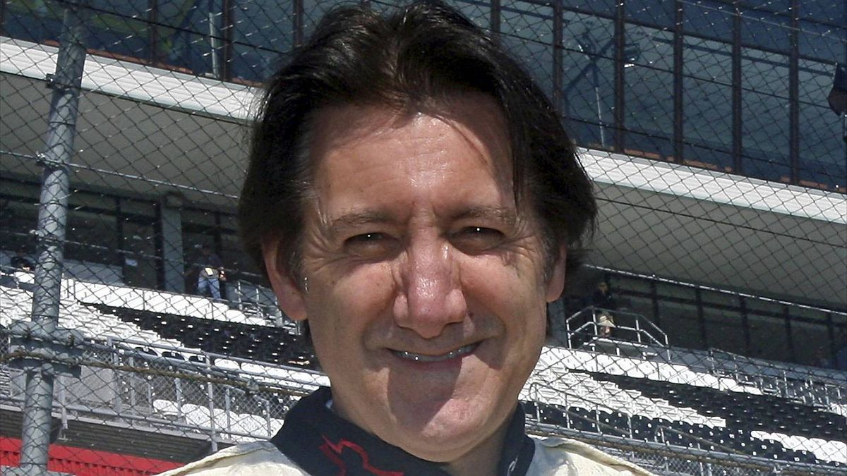 Ron Fellows poses with his 2001 Daytona winning Chevrolet Corvette before the Rolex 24 at Daytona, January 28, 2011.