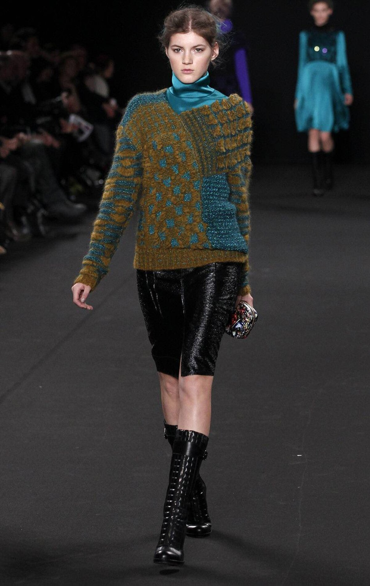 And … no. In fact, the best-case scenario for this sweater is that it stays a 'runway showpiece' (translation: never makes it to stores).