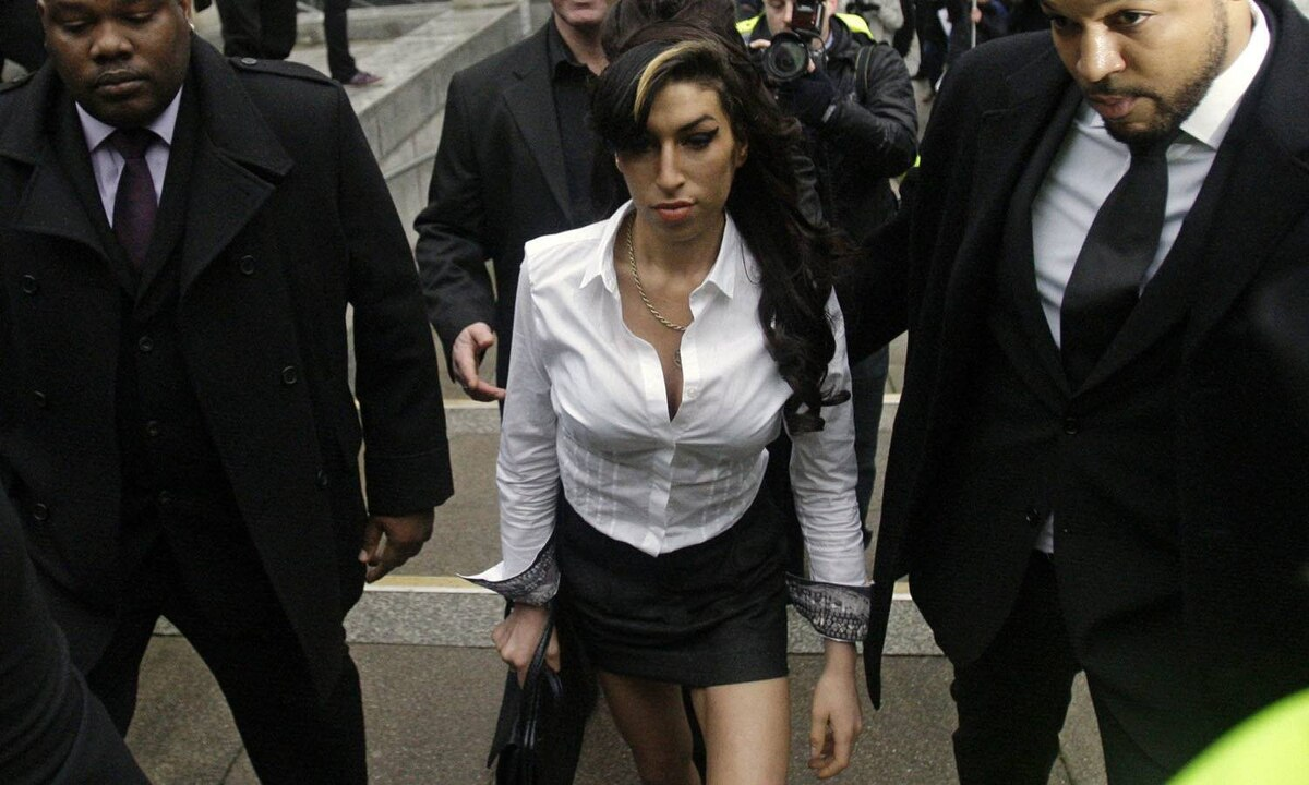 Amy Winehouse arrives at Magistrates Court in Milton Keynes, England, on Jan. 20, 2010. She avoided jail time after being accused of assaulting a theatre manager.