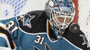 San Jose Sharks goalie Antti Niemi deflects a shot on goal from the Edmonton Oilers during the first period of an NHL hockey game Tuesday, March 6, 2012, in San Jose, Calif. The Sharks face the Flames in Monday's must see NHL game. (AP Photo/Ben Margot)