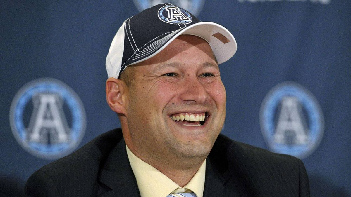 Scott Milanovich smiles after being announced as the new head coach of the Toronto Argonauts in December, 2011.