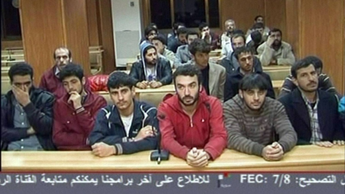 An image taken from Syrian state TV on Wednesday shows some of the 1,000 Syrian prisoners freed on Tuesday in an apparent last-ditch bid to placate Arab leaders as Turkey and the UN warned President Bashar al-Assad to stop killing his own people.