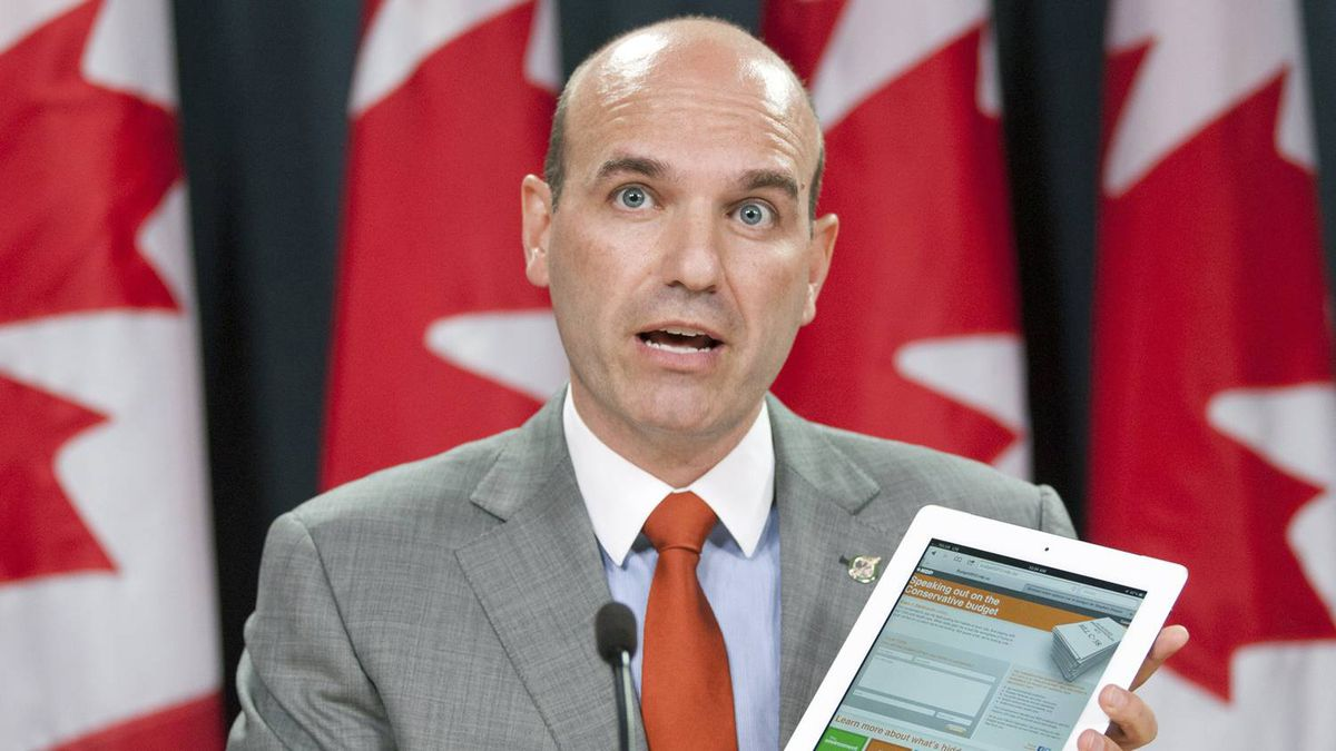 Opposition House Leader Nathan Cullen shows off an NDP website seeking public comments on the Conservative budget at an Ottawa news conference on May 15, 2012.