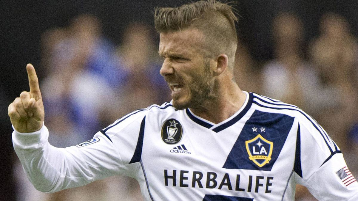 LA Galaxy's David Beckham argues a call with the referee as they face the Montreal Impact during first half MLS soccer action in Montreal on Saturday, May 12, 2012. THE CANADIAN PRESS/Paul Chiasson