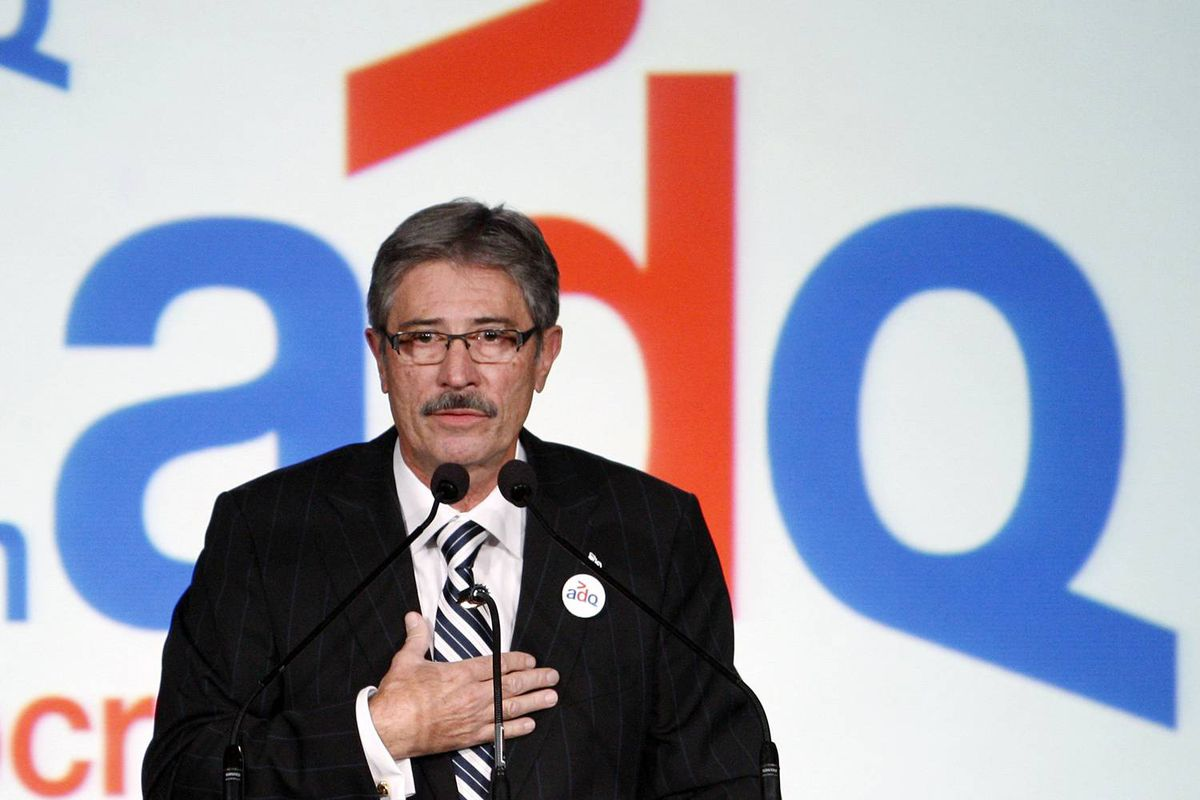 Newly elected Action Democratique du Quebec Leader Gilles Taillon speaks to supporters in Quebec City on October 18, 2009.