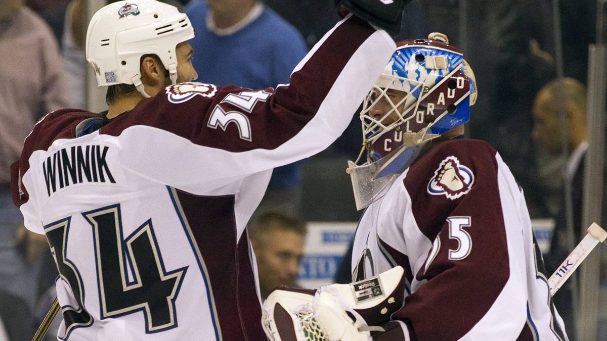 Colorado Avalanche goaltender Jean-Sebastien Giguere and left winger Daniel Winnik celebrate their overtime win against the Toronto Maple Leafs in NHL action in Toronto on Monday October 17, 2011. THE CANADIAN PRESS/Frank Gunn