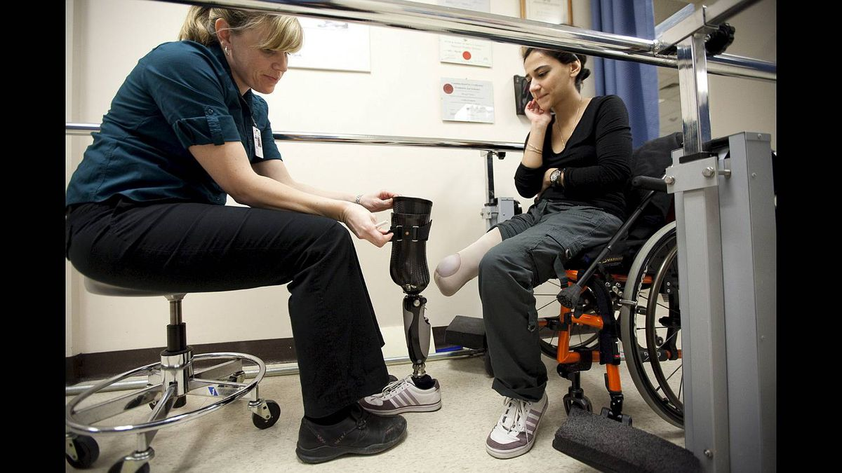 Prosthetist Laura Scholtes works with Bushra Saeed as she gets her leg fitted at the Rehabilitation Centre in Ottawa