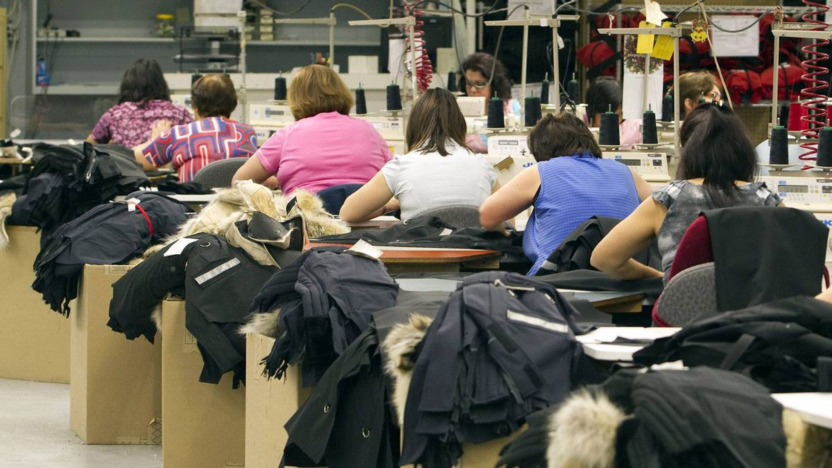 Workers piece together outerwear on the manufacturing floor of Canada Goose's facility in Toronto Jan. 17, 2012. Despite significant challenges, Canadian manufacturers have managed to make some impressive gains over the past decade.