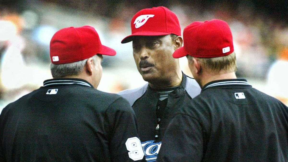 Toronto Blue Jays manager Cito Gaston confers with the umpires about having the lights turned on during the fifth inning of their game against the Baltimore Orioles in Baltimore, Maryland, on Monday.