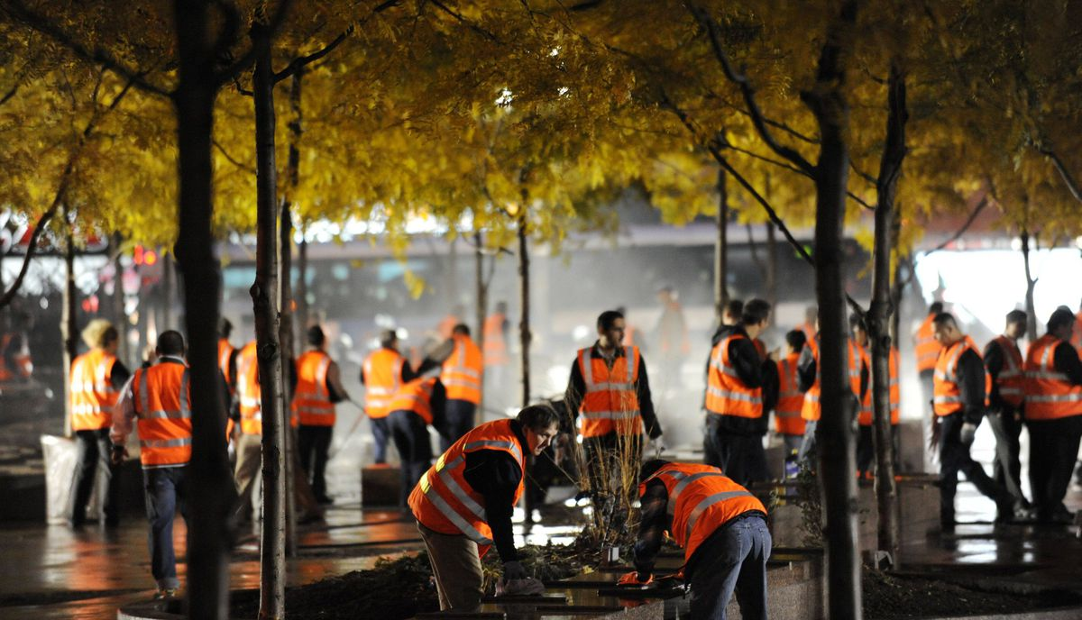 New York City sanitation crews clean Zuccotti Park after city officials evicted the 'Occupy Wall Street' protest from the park in the early morning hours of November 15, 2011 in New York.