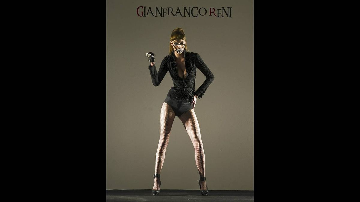 A model displays a creation by Mexican designer Gianfranco Reni during the Mercedez Benz Fashion 2011 in Mexico City, on March 9, 2011.
