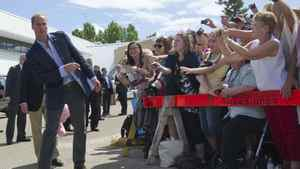 Prince William looks down the line of the gathered crowd during a visit to Slave Lake, Alberta July 6, 2011.