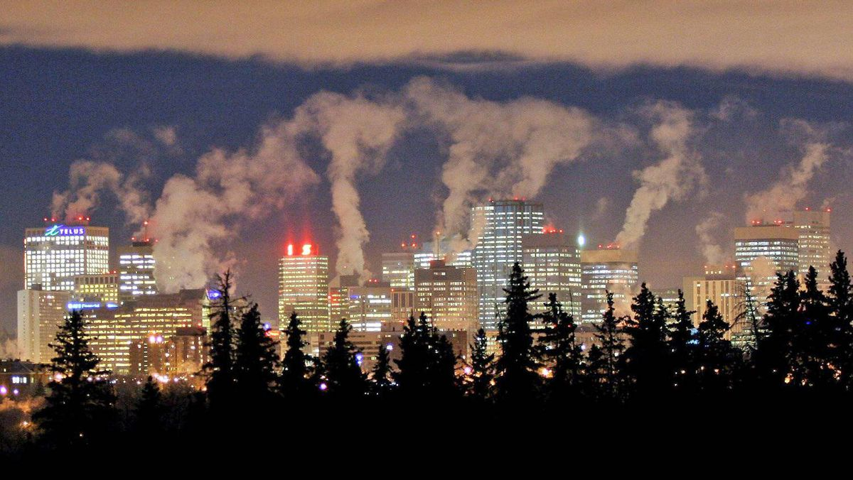 Smoke rises from downtown Edmonton's skyline on Dec. 16, 2005.
