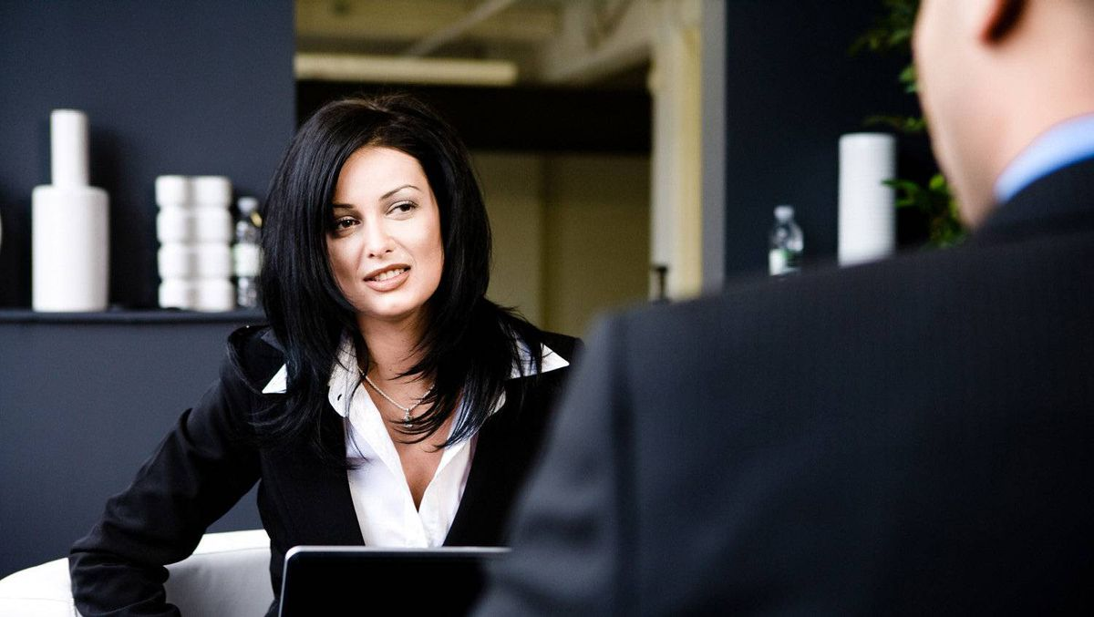 Businesswoman interviewing a man.