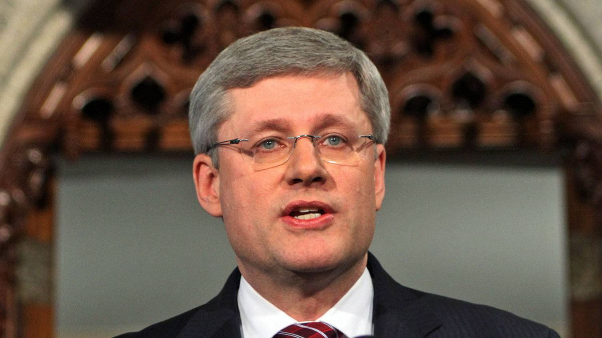 Prime Minister Stephen Harper speaks to reporters after the collapse of his minority government in the foyer of the House of Commons on March 25, 2011.
