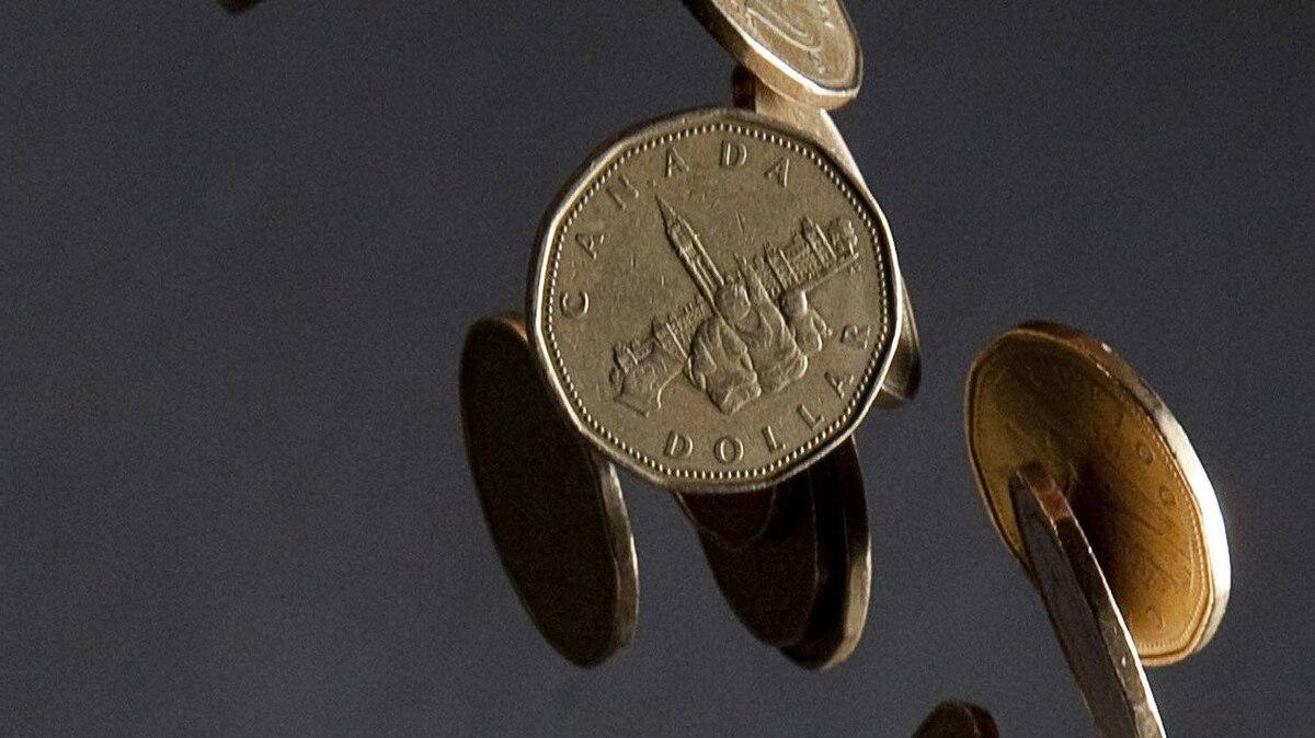 Canadian dollars fall through the air.