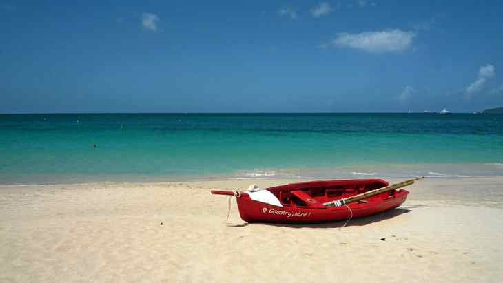 A quiet moment on Grand Anse beach in Grenada: The three-kilometre white-sand beach on the Caribbean Sea is a popular destination for tourists and locals alike.