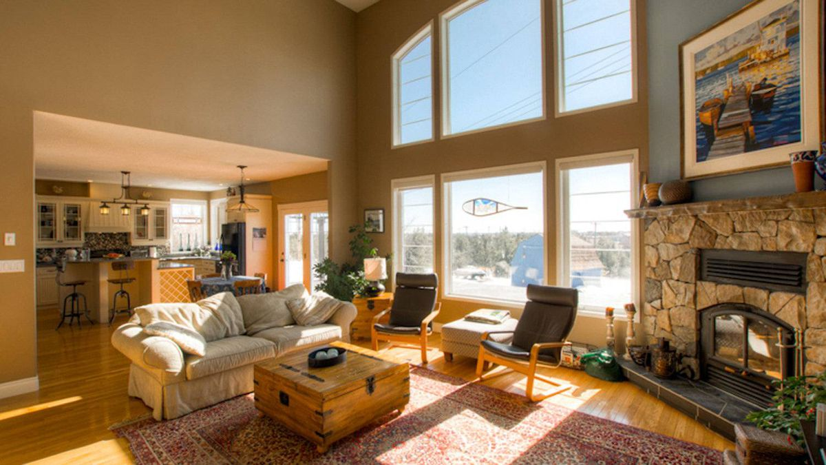 The vaulted living room features a fieldstone wood-burning fireplace.