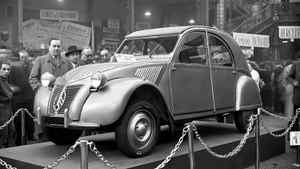 The Citroen 2CV is revealed to the public for the first time at the 1948 Paris Car show. The 2CV was designed to carry two peasant farmers and 100 kilos of farm goods to market at 60 kilometers per hour along roads ripped apart by artillery shells and steel tank tracks.