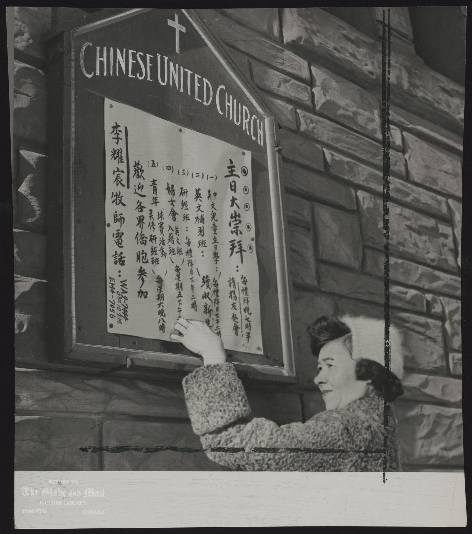CHINESE IN TORONTO A major building project for Toronto's Chinese in planned just outside Chinatown. Sign is placed on bulletin board outside the Chinese United Church on Chestnut St by Mrs Tong Wong.