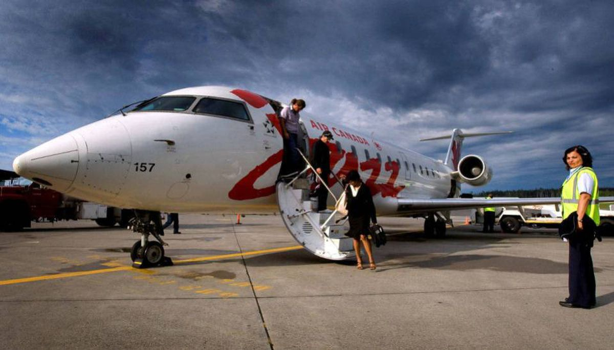 Passengers disembark an Air Canada Jazz flight after flying on a Canadair Regional Jet in Prince George from vancouver.