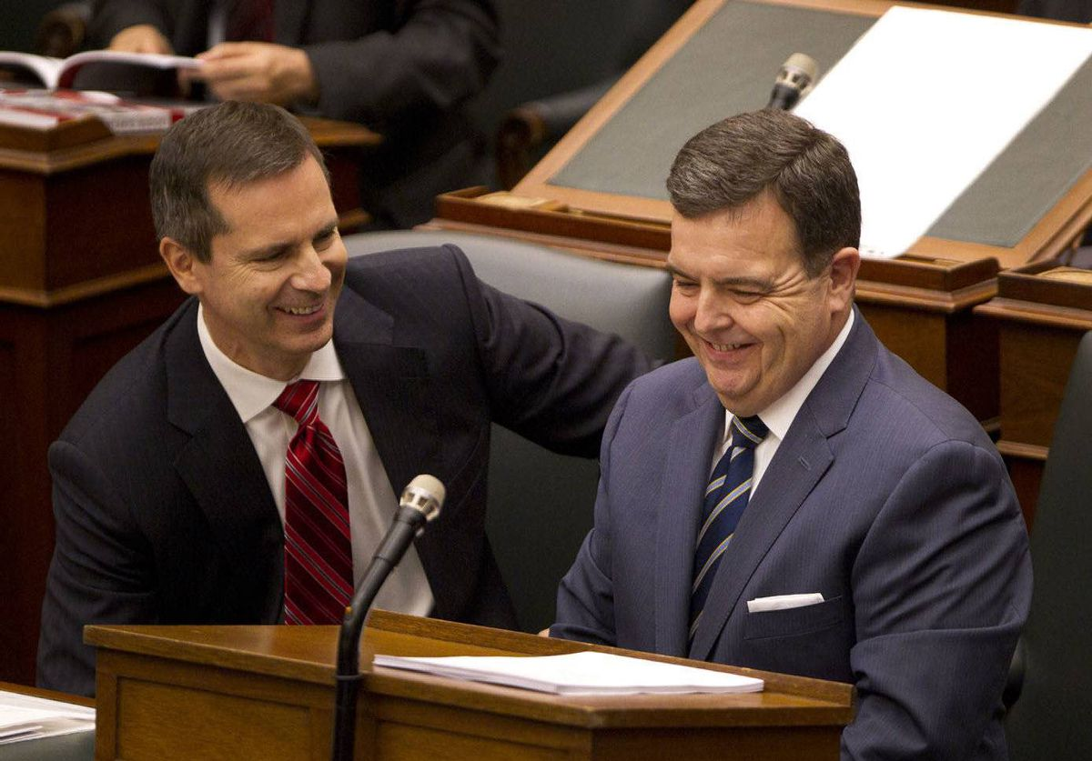 Ontario Premier Dalton McGuinty, left, and Finance Minister Dwight Duncan smile after Duncan delivered the budget in the Legislature at Queen's Park in Toronto.