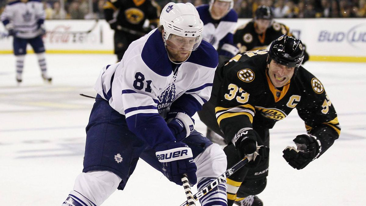 Toronto Maple Leafs right wing Phil Kessel (81) tries to get around Boston Bruins defenseman Zdeno Chara of Slovakia during the third period of Boston's 2-0 win in an NHL hockey game in Boston on Thursday, Oct. 28, 2010.