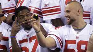 New York Giants linebacker Spencer Jacquian Williams, left, and Mark Herzlich have some fun during media day in Indianapolis.