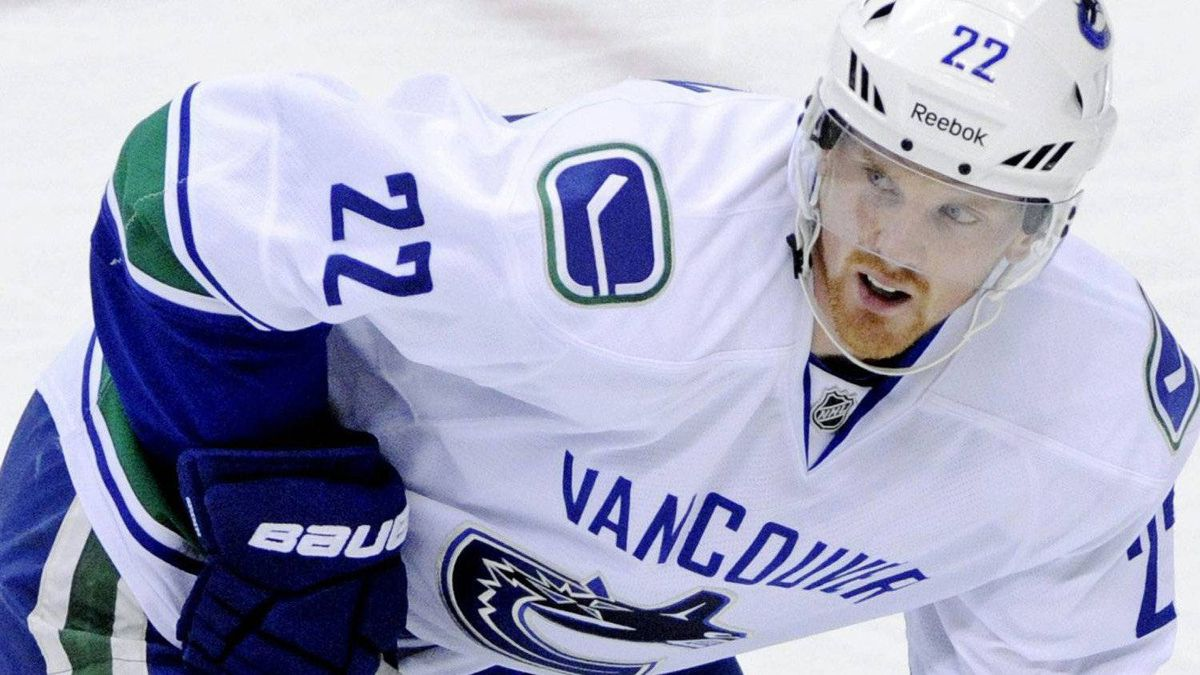 In this Nov. 3, 2011, photo, Vancouver Canucks' Daniel Sedin, of Sweden, looks for the puck during an NHL hockey game against the Minnesota Wild in St. Paul, Minn. Canucks coach Alain Vigneault says injured winger Sedin has a concussion. The team remains mum on the left wing's condition, or if he will be able to return to action before the playoffs. (AP Photo/Jim Mone)