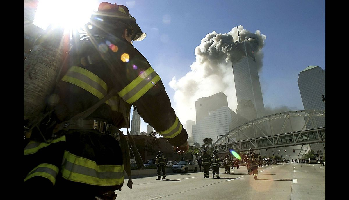 Firefighters walk towards one of the towers at the World Trade Center before it collapsed after a plane hit the building Sept. 11, 2001 in New York City.