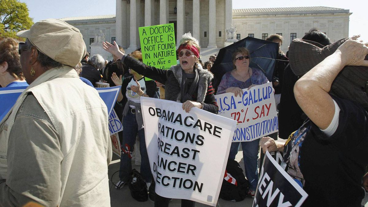 Protesters against President Barack Obama's healthcare law (C) shout slogans against those marching in support of it, during the first day of legal arguments over the Affordable Care Act, outside the Supreme Court in Washington March 26, 2012. )