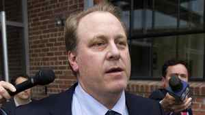 Former Boston Red Sox pitcher Curt Schilling, center, is followed by members of the media as he departs the Rhode Island Economic Development Corporation headquarters, in Providence, R.I., Wednesday, May 16, 2012.