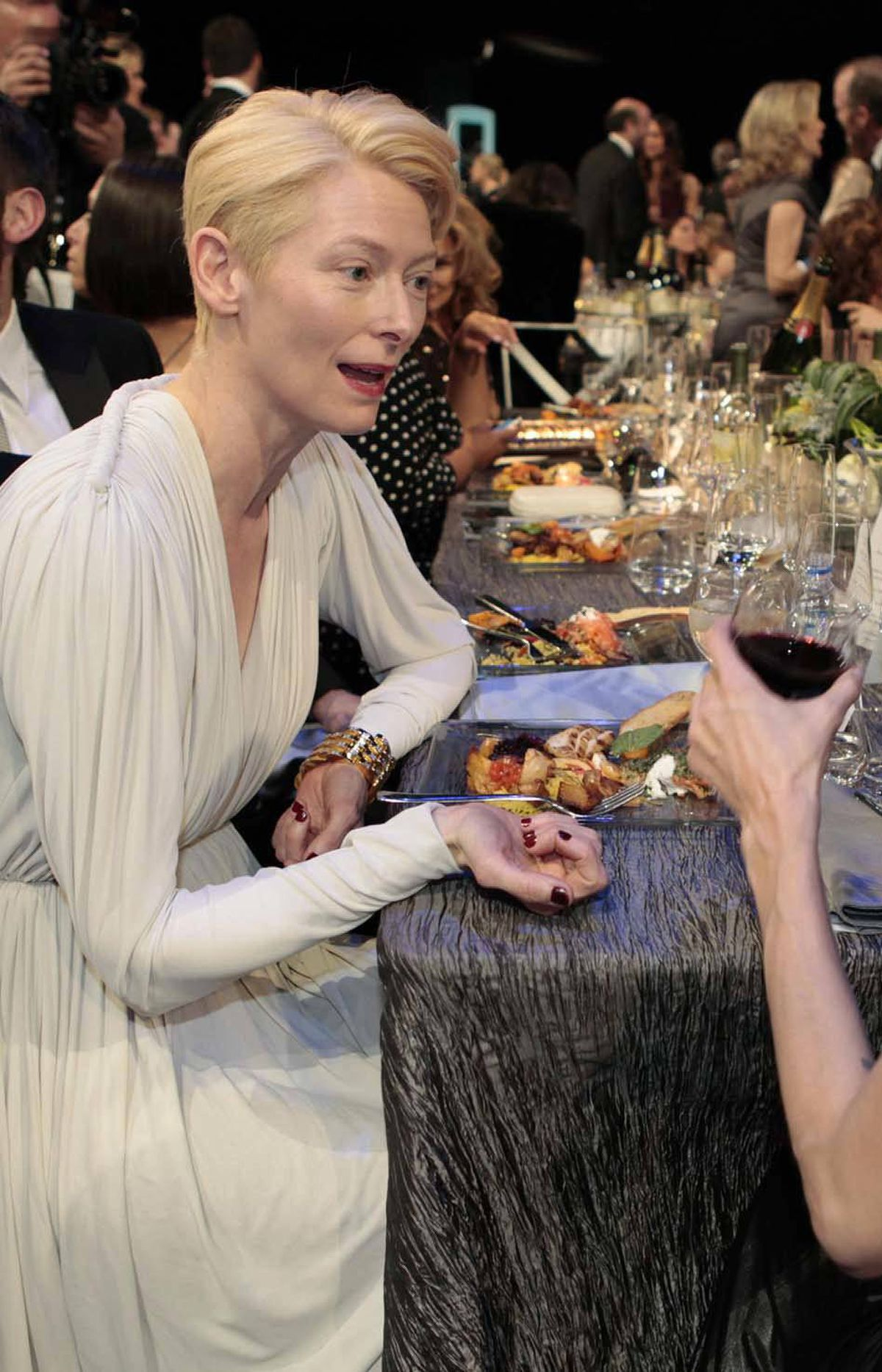 Tilda Swinton, seen here chatting with Angelina Jolie at the SAG awards Sunday, wore a gown made from the pure driven snows of the Alberta boreal forest.