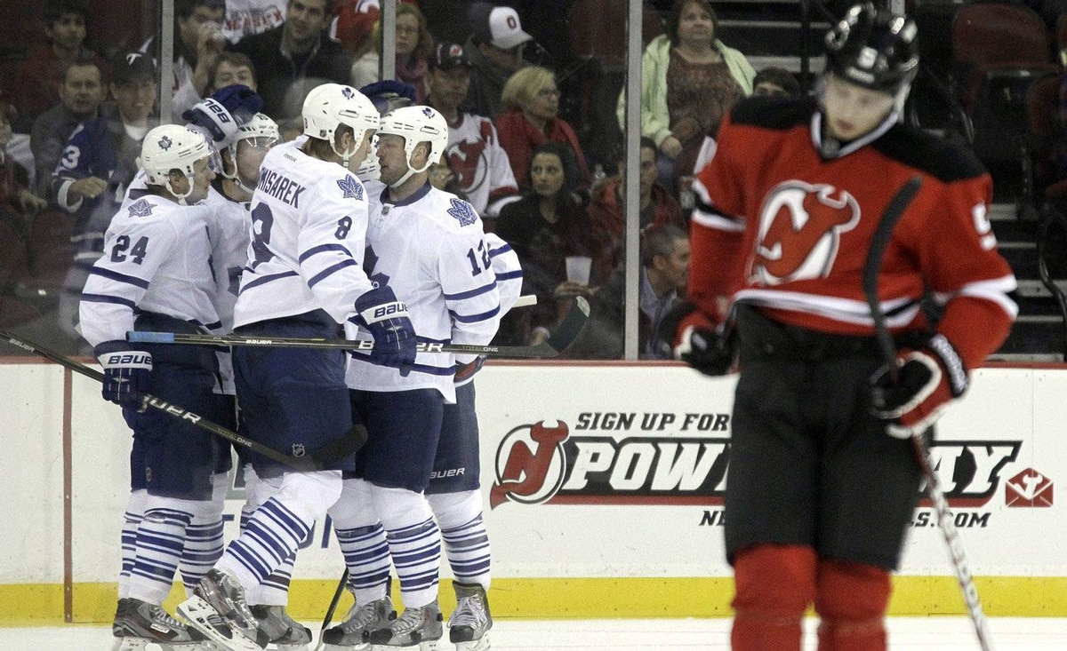 New Jersey Devils' Adam Larsson, right, of Sweden, reacts as members of the Toronto Maple Leafs celebrate a goal by Joffrey Lupul during the second period of an NHL hockey game on Wednesday, Nov. 2, 2011, in Newark, N.J.