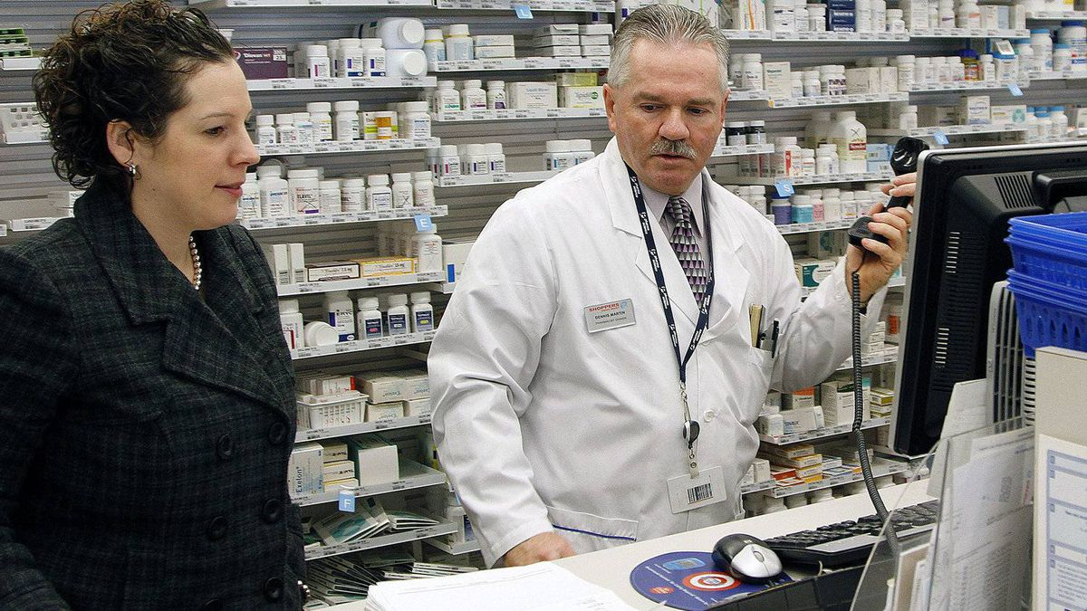 Jenny Shickluna, an official with the seniors program in Niagara Region, talks with Dennis Martin, pharmacist at Shoppers Drug Mart, who is helping her with Gatekeeper, a program started by the city aimed at identifying at-risk seniors.