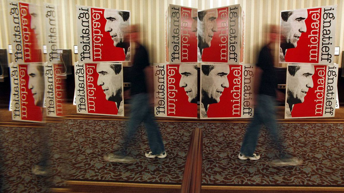 A man walks past Michael Ignatieff signs at the Liberal Party's election-night rally in Toronto on May 2, 2011.