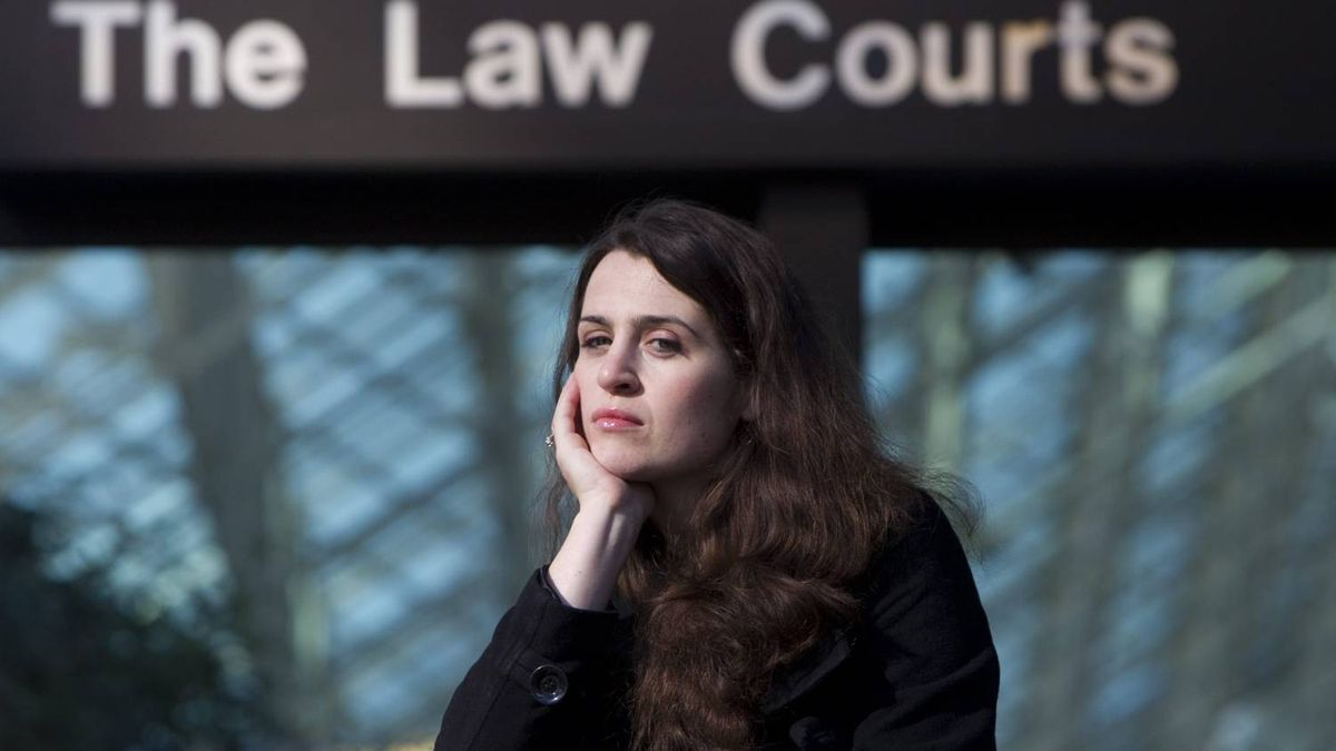 Toronto-based The Canadian Press journalist Olivia Pratten poses for a photo outside the B.C. Supreme Court in Vancouver, Wednesday, Oct. 27, 2010. Pratten's lawyers contend she and other children of artificial insemination are treated as second-class citizens because they're not afforded the same rights as adopted children.